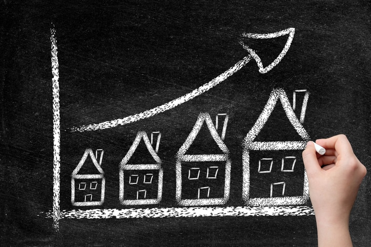 House real estate, mortgage graph with ascending price arrow and woman's hand